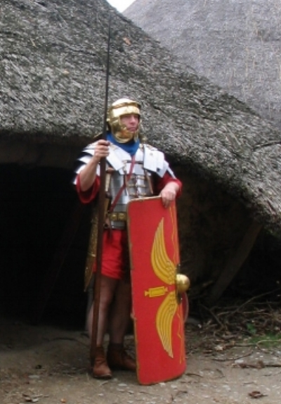 Depiction of a Roman soldier outside an Iron Age dwelling